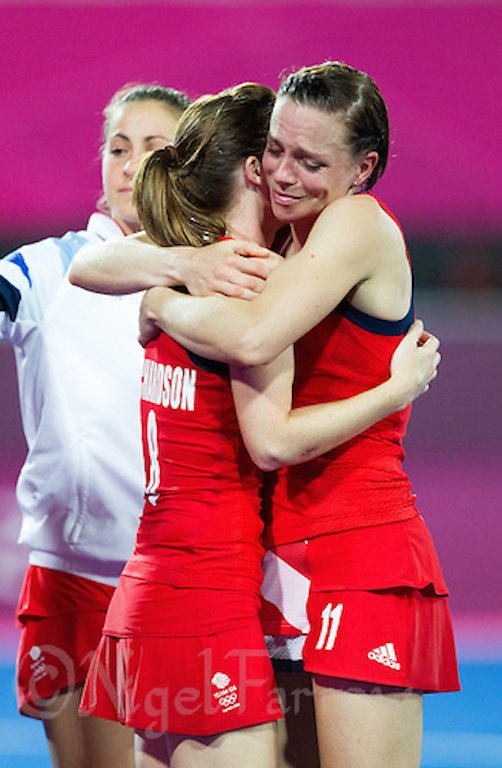 08 AUG 2012 - LONDON, GBR - Kate Walsh (GBR) (right) and Helen Richardson (GBR) console each other after Great Britain lost 2-1 to Argentina in the London 2012 Olympic Games semi final hockey match at the Riverbank Arena in Stratford, London, Great Britain (PHOTO (C) 2012 NIGEL FARROW)